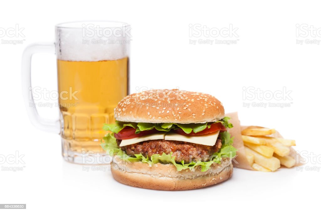 Burger, beer and french fries stock photo