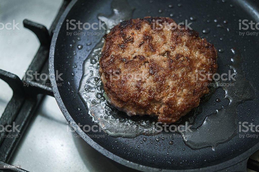 burger cutlet on metal pan stock photo