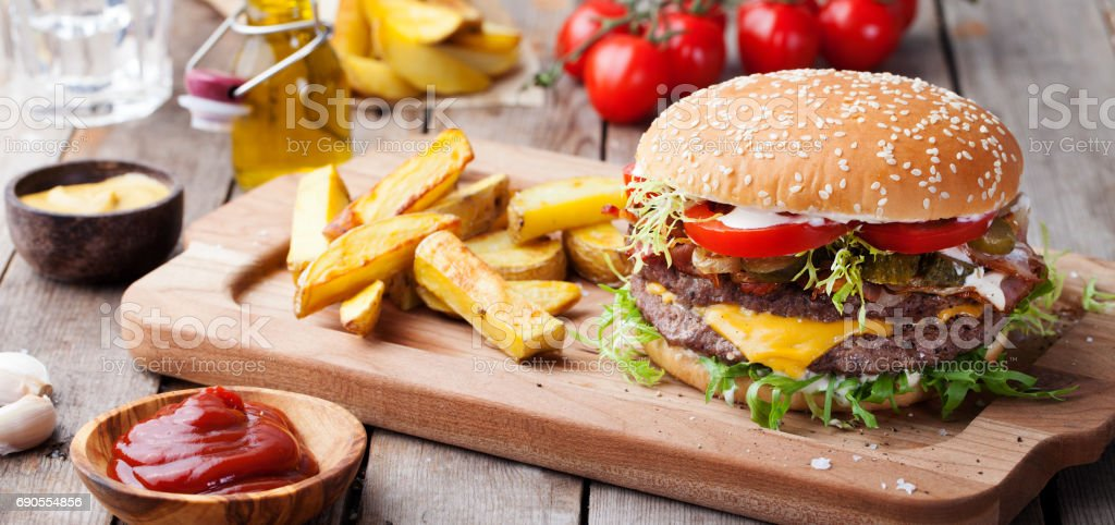 Burger, hamburger with french fries Cutting board. stock photo