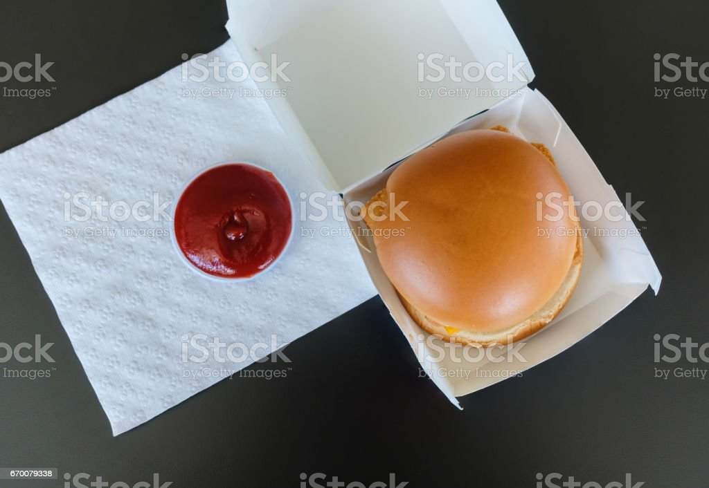 burger in a box serving with ketchup sauce stock photo