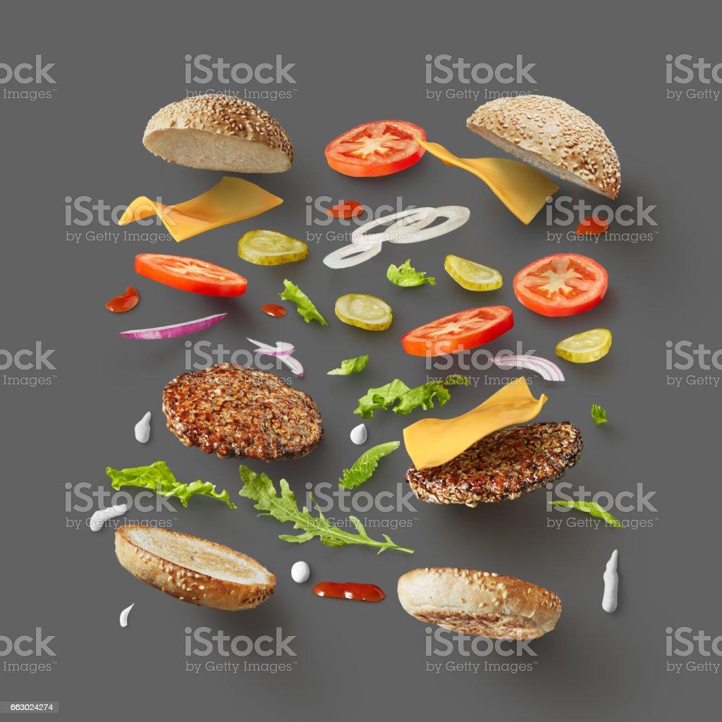 Burger ingredients against dark grey background stock photo