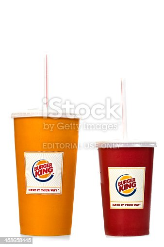 Alanya, Turkey - Jaunary 15, 2012: A Burger King disposable cups includes a soda and cola drink, studio shot. Disposable cups are yellow and red.