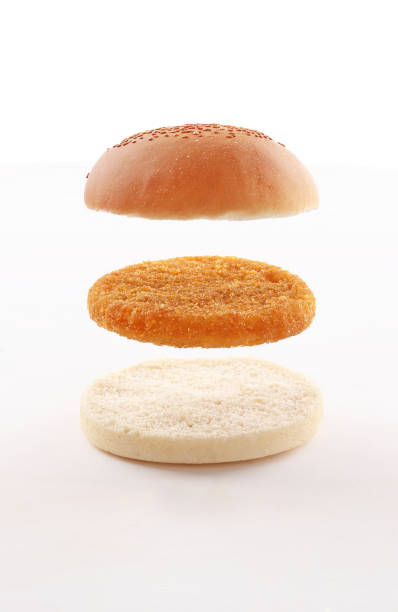 burger layers, bun, toast bread and cheese on white background - burger and chicken zdjęcia i obrazy z banku zdjęć