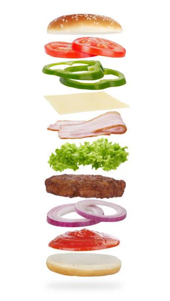 burger-levitation - gemüselaibchen stock-fotos und bilder