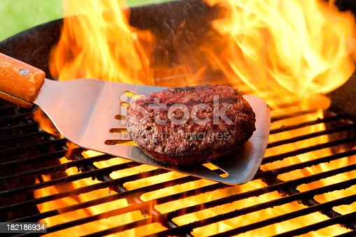 Juicy burger on the grill kissed by fire