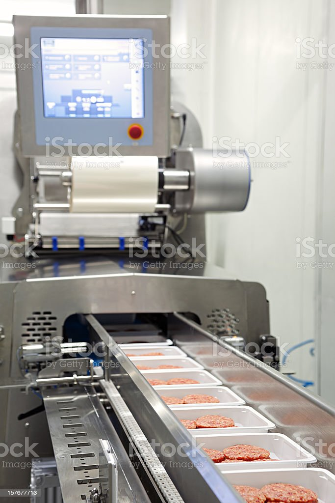 Burger Production / Packing stock photo