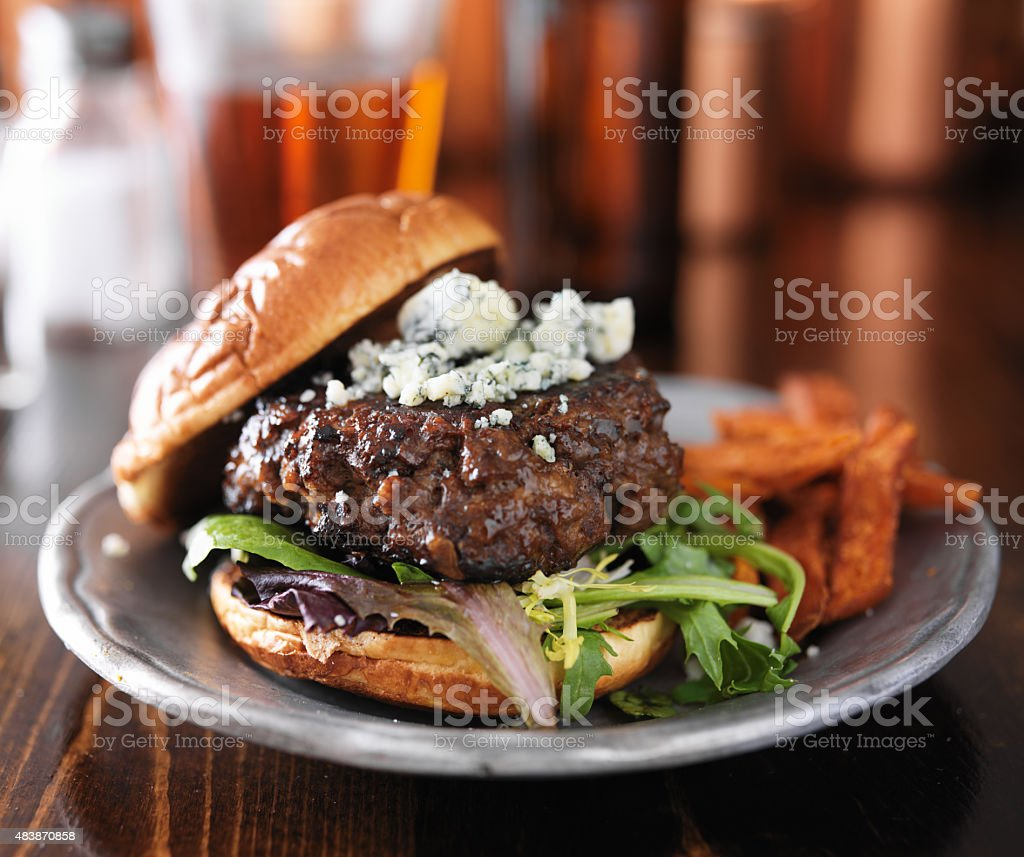 burger with blue cheese served with beer stock photo