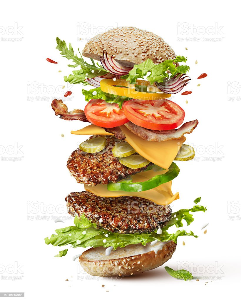 burger with flying ingredients stock photo