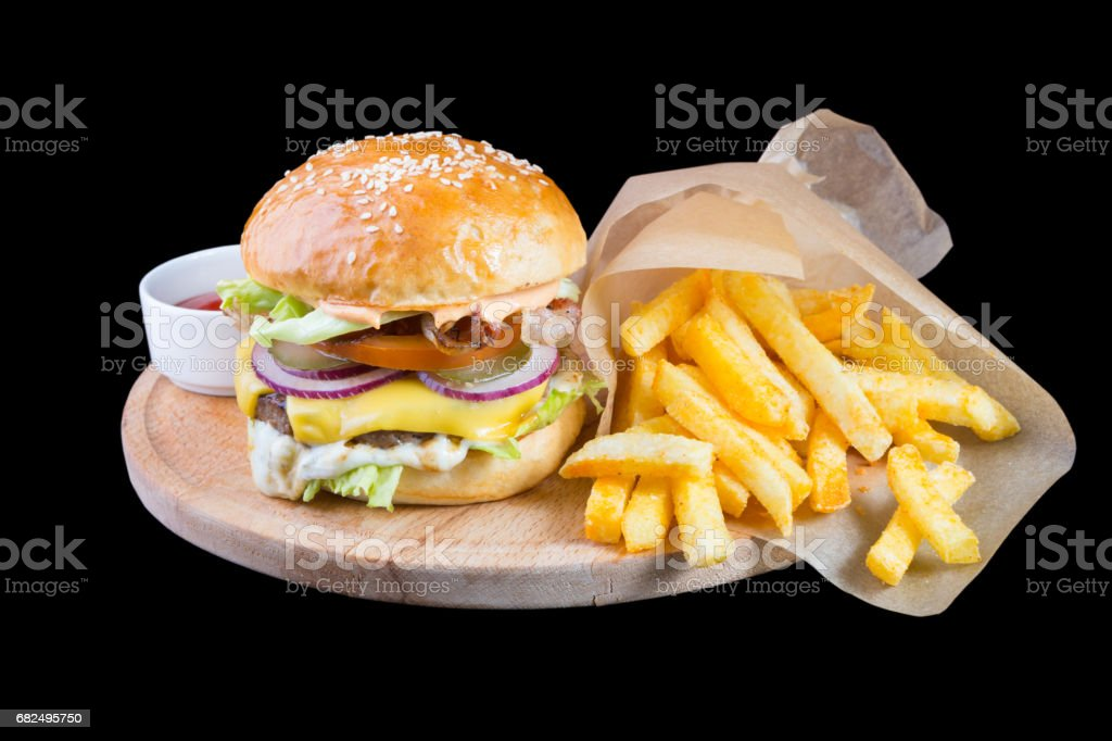 Burger with french fries isolated on a black background foto stock royalty-free