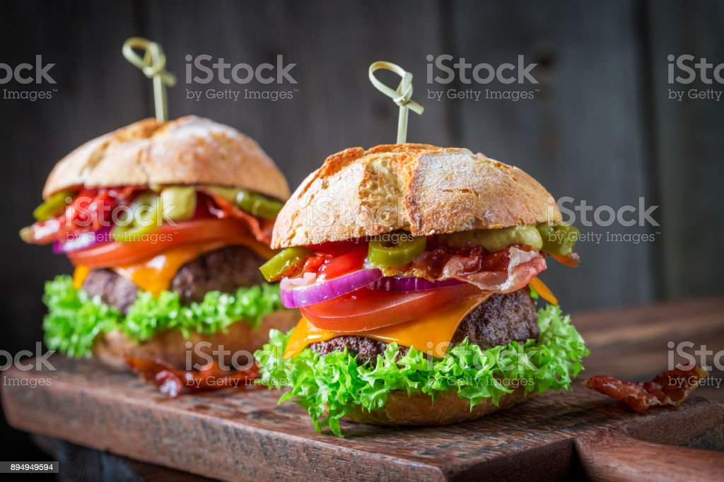 Burger with fresh beef, cheese and vegetables stock photo