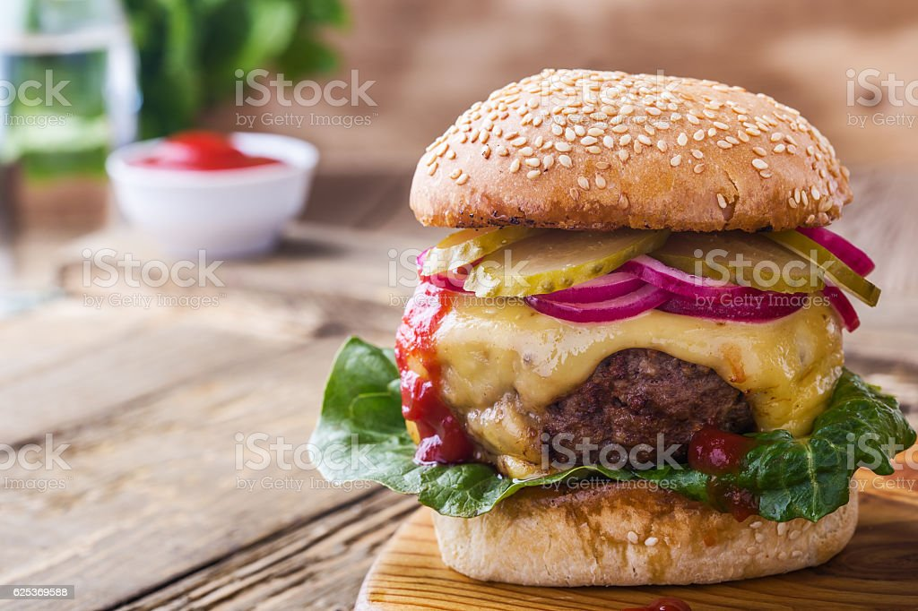 Burger with  gherkins, red onion and lettuce stock photo