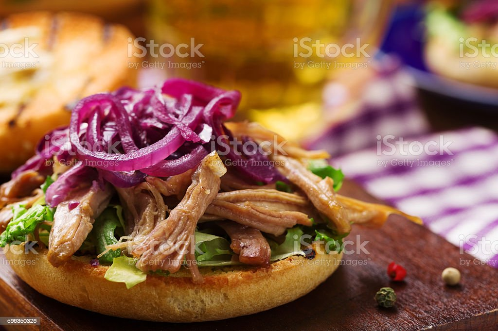 Burger with meat of duck with red onion and lettuce. royalty-free stock photo