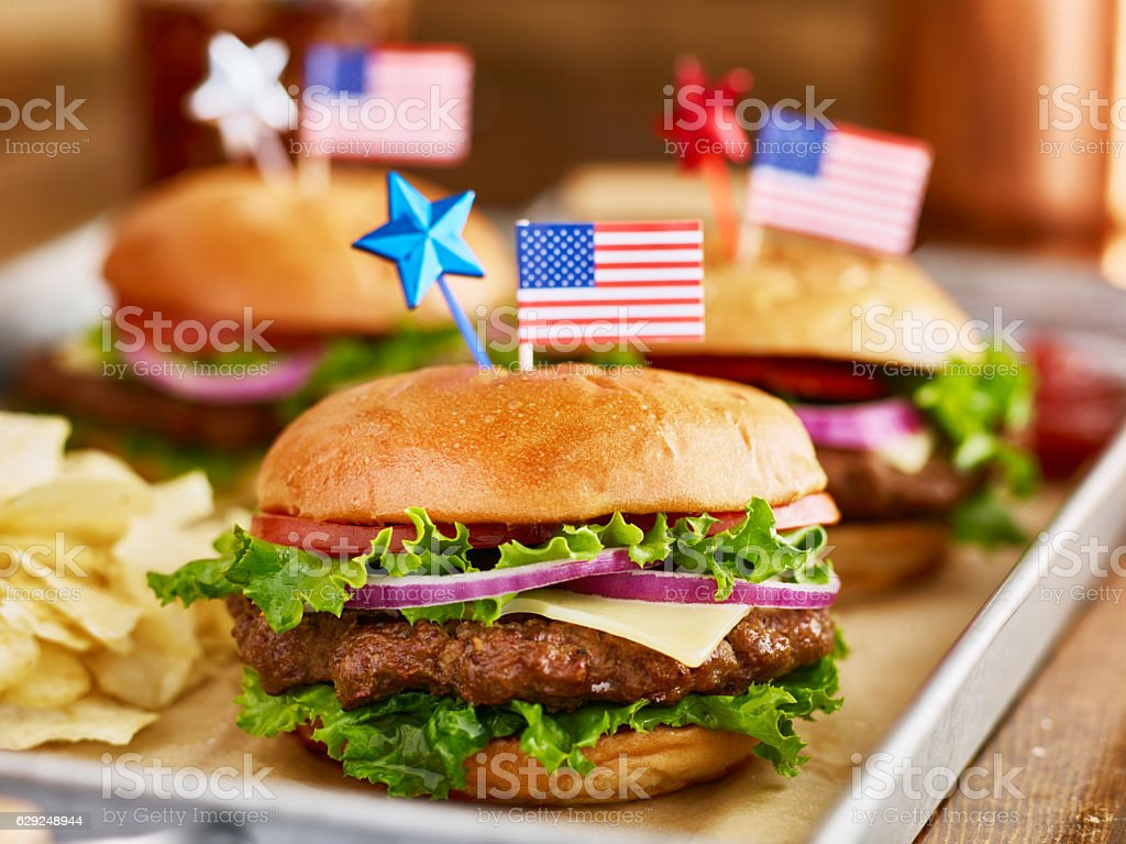 burgers and potato chips with american flags patriotic theme stock photo