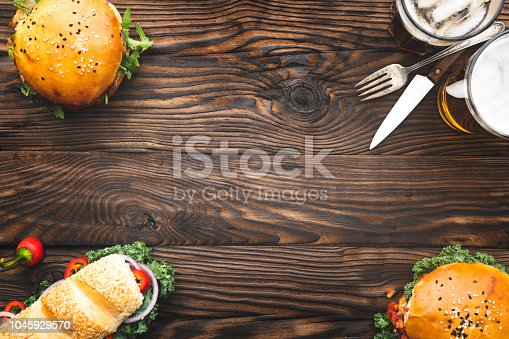 Fresh burgers and sandwich meal on wooden background. Top View