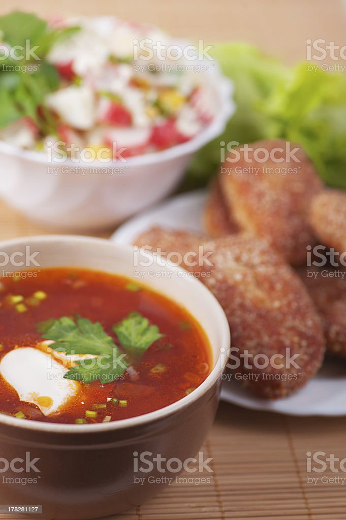 Burgers, crab salad and Russian borscht royalty-free stock photo