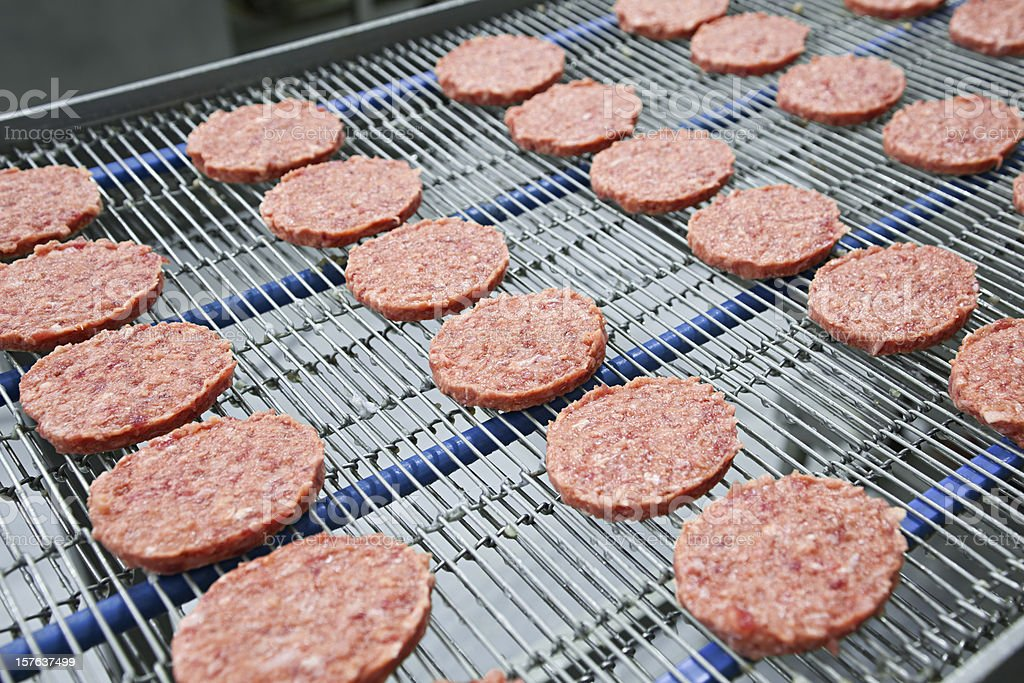 Burgers on Conveyor stock photo