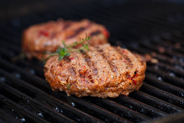 burgers on party summer barbecue grill with flame stock photo