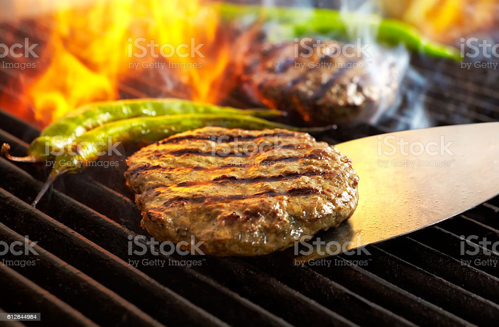 Burgers On The Hot Flaming Barbecue stock photo