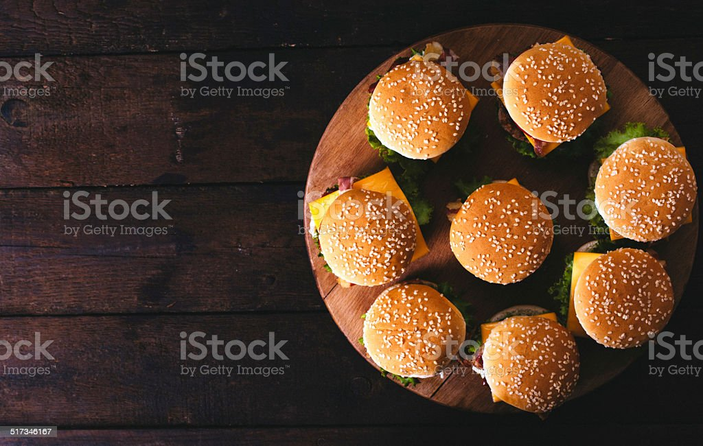 Burgers on the wooden background stock photo