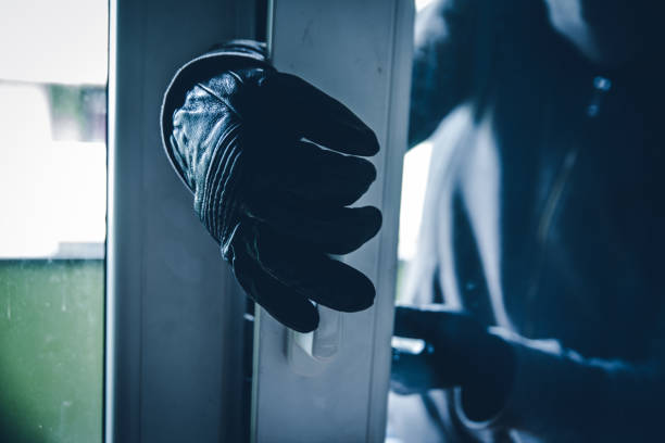 burglar breaking into house - thief stock photos and pictures