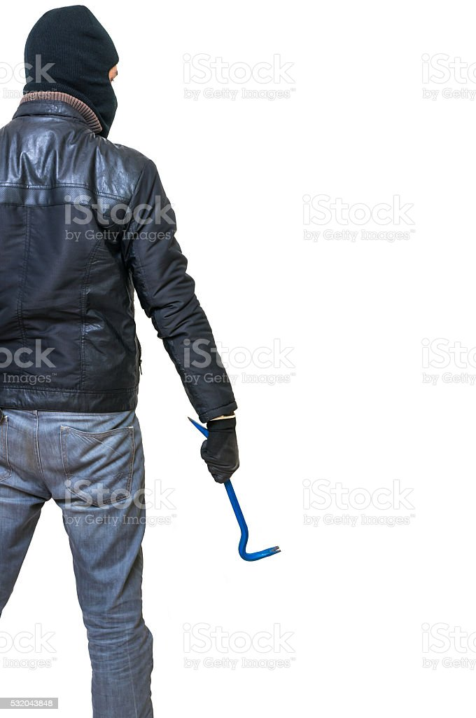 Burglar from behind holds crowbar in hand. Rear view. stock photo