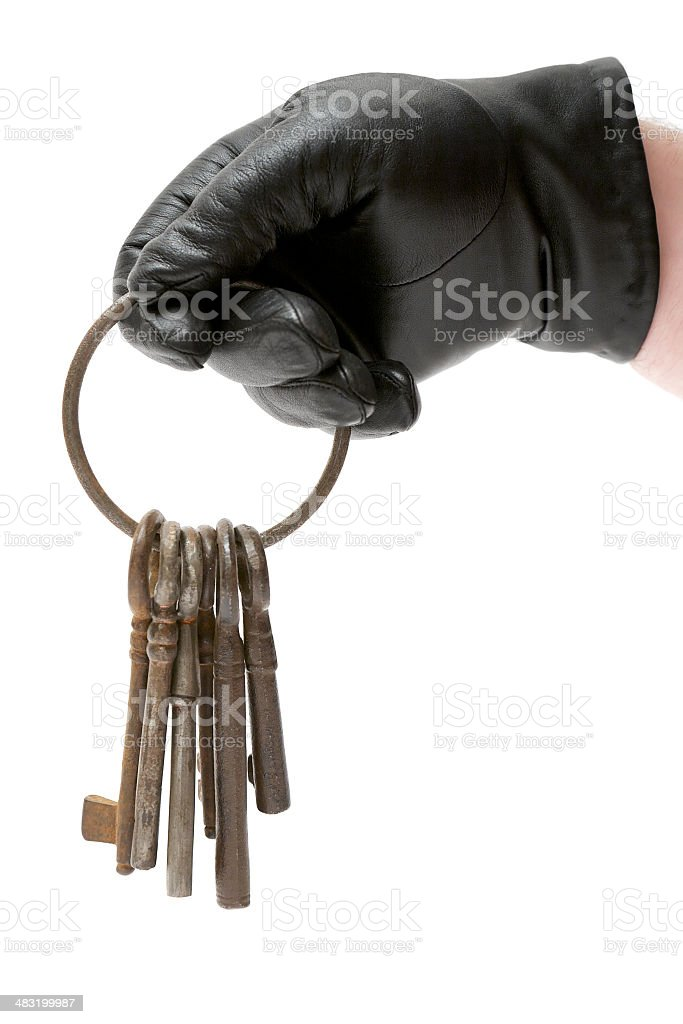 Burglar Holding a Bunch of Old Keys royalty-free stock photo