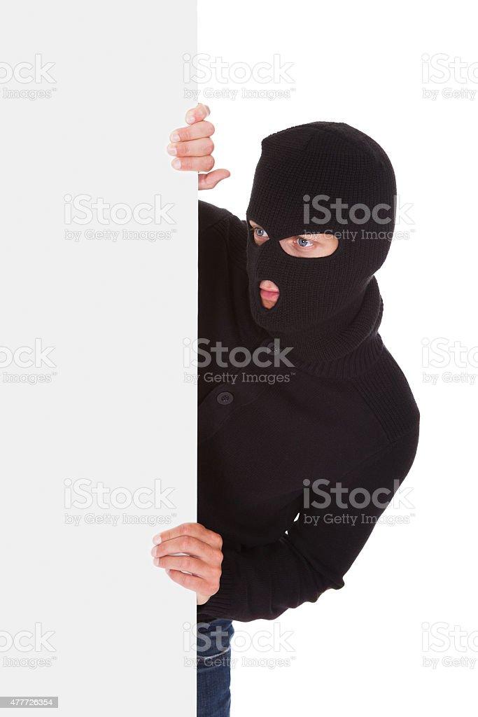 Burglar Holding Blank Placard stock photo