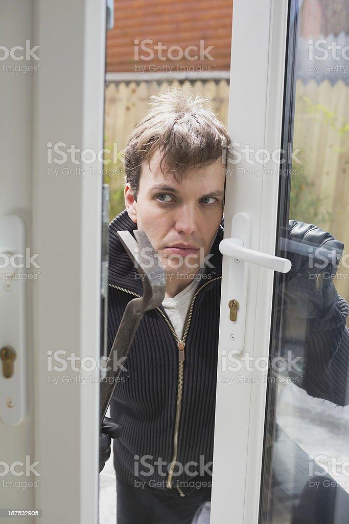 Burglar looking around before going in stock photo