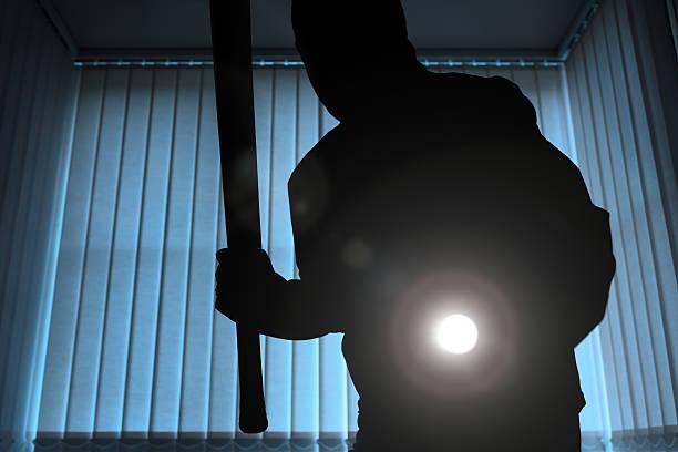 Burglar or intruder at night stock photo