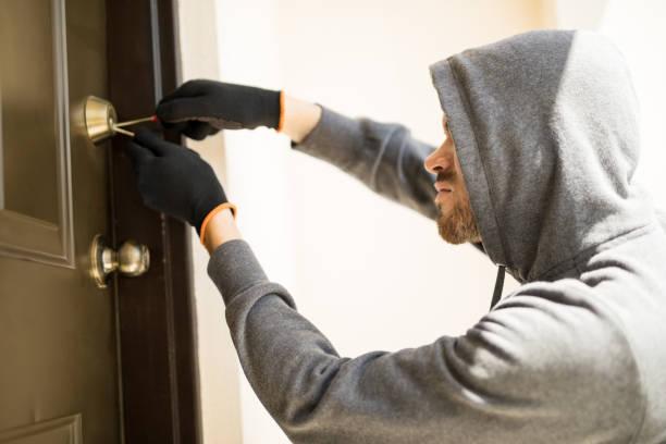 Burglar picking lock of a house stock photo