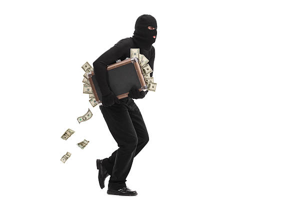 burglar running with a bag full of money - thief stock photos and pictures