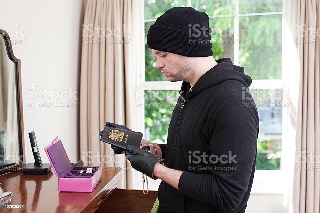 Burglar stealing passport stock photo