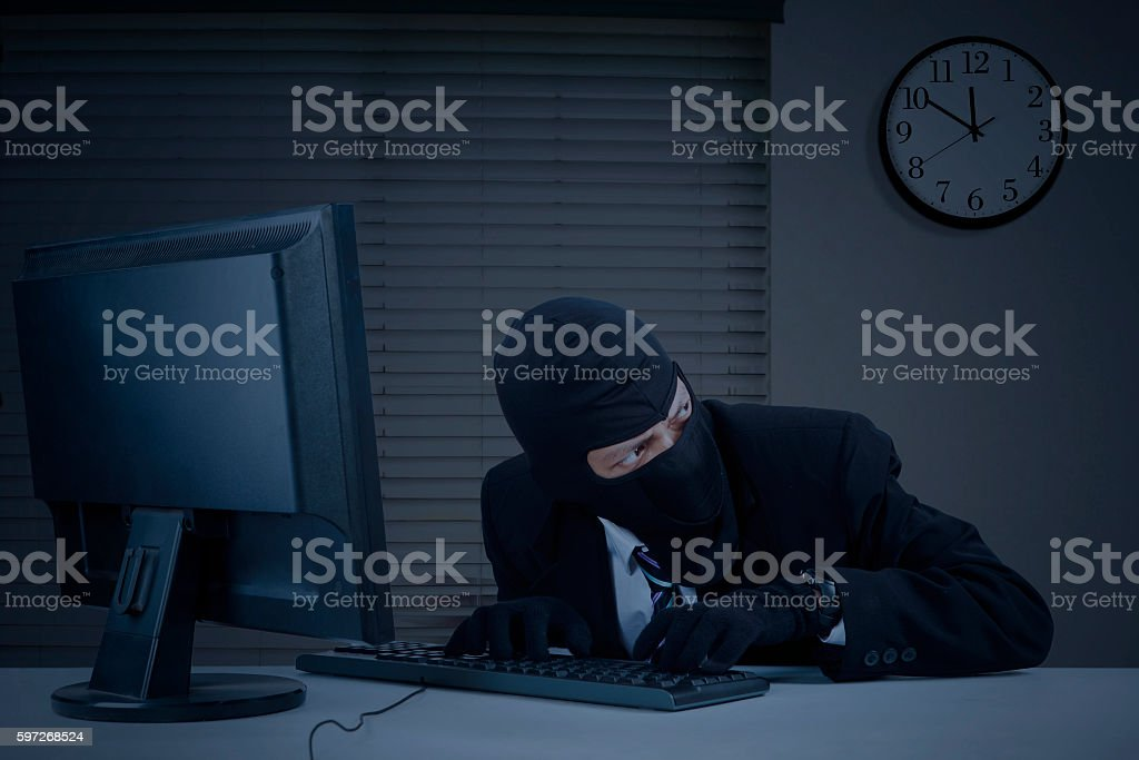 Burglar takes information in office royalty-free stock photo
