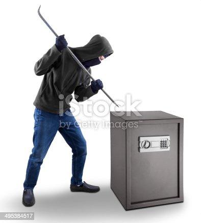 istock Burglar tries to open a safe deposit box 495384517