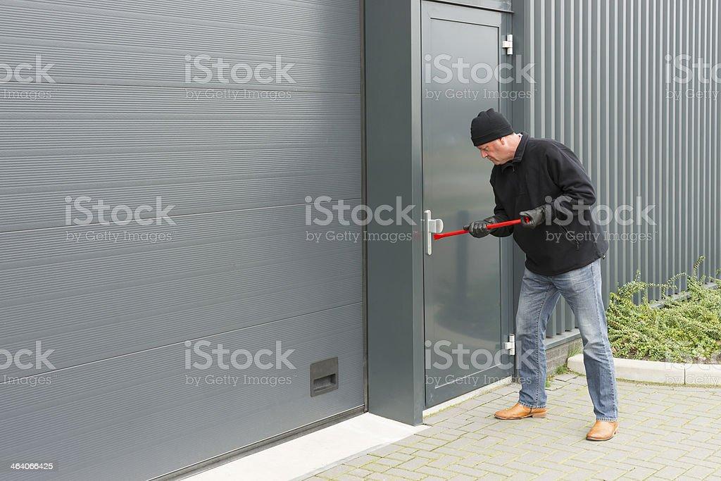 burglar with a crowbar royalty-free stock photo