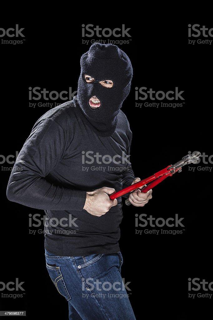 Burglar with balaclava stock photo