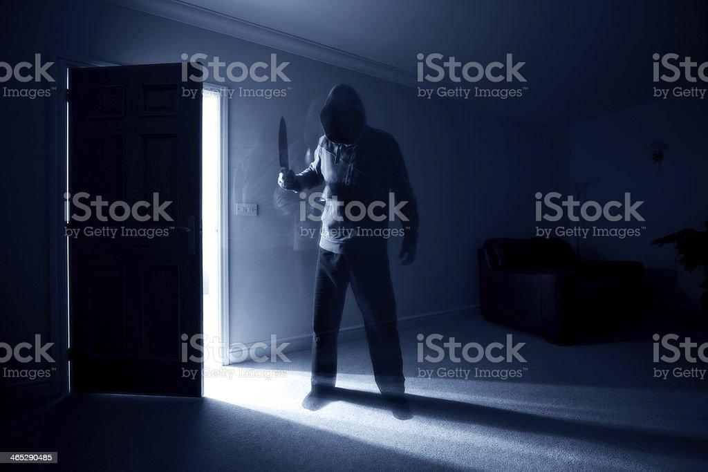 Burglar with knife stock photo