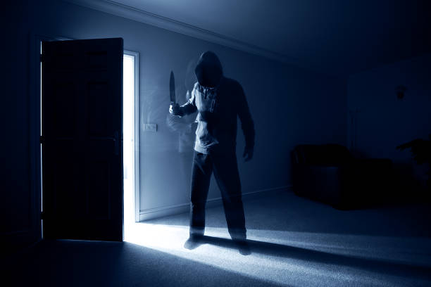 burglar with knife - killer stock pictures, royalty-free photos & images
