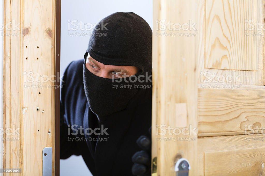 Burglary - culprit opens a door stock photo