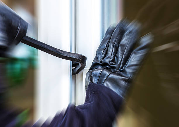 burglary into a house - stealing crime stock photos and pictures