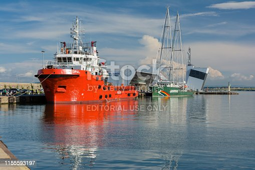 Burgas, Bulgaria - June 9, 2019: Greenpeace Rainbow Warrior sailing ship and Opal Valletta Offshore Supply Ship at the Port of Burgas, Bulgaria.
