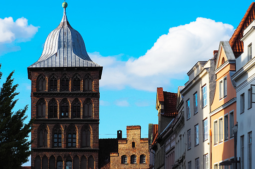 Burgtor, northern gate of the old town of Lubeck. Schleswig-Holstein, Germany. Roofs of ancient city