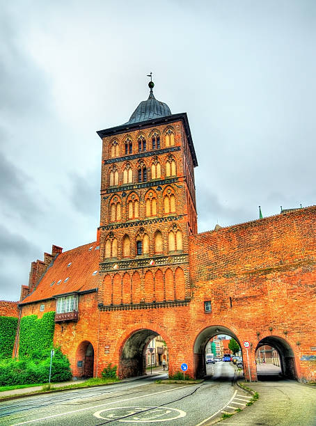 burgtor, the northern gate of lubeck, germany - nordsee urlaub hotel stock-fotos und bilder