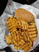 One burguer with grill-shaped potatoes