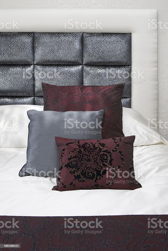 burgundy and gunmetal silk cushions royalty-free stock photo
