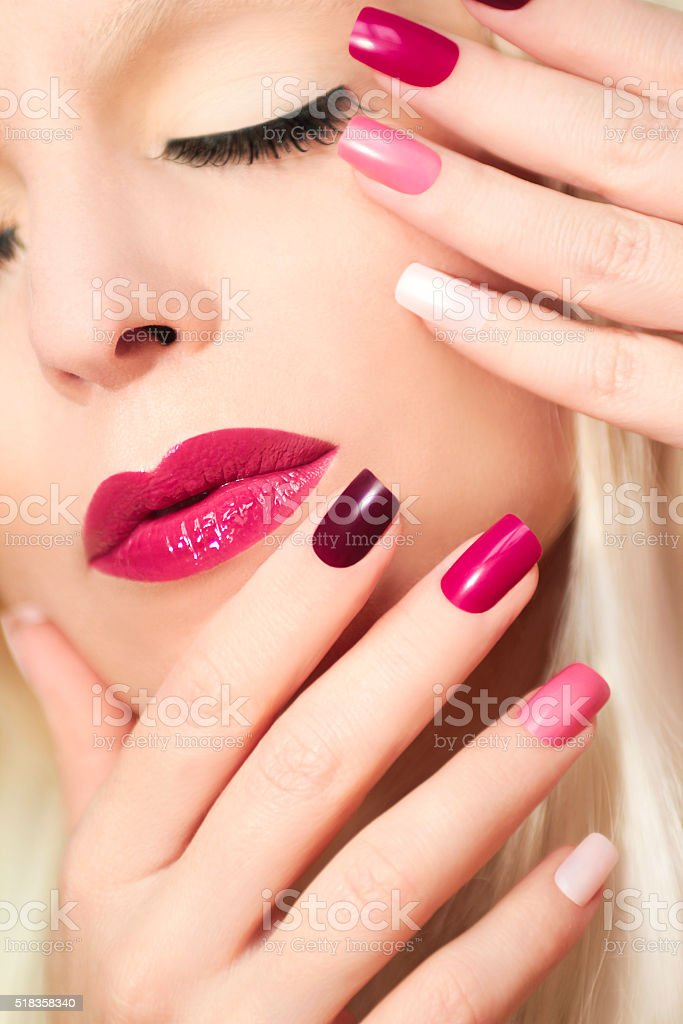 Burgundy colored manicure . stock photo