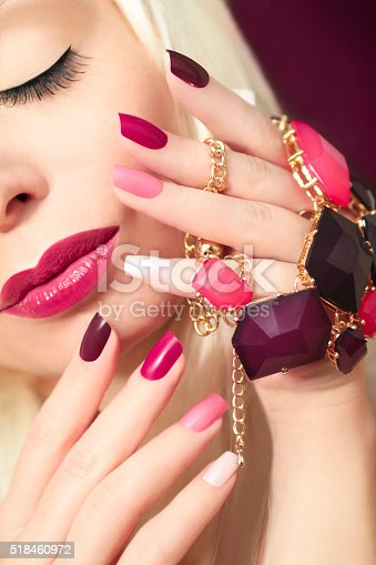 946930880istockphoto Burgundy colored manicure. 518460972