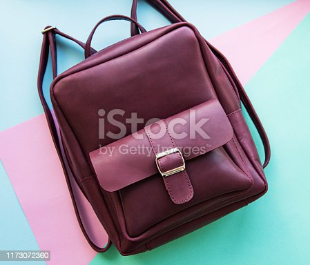 175597083 istock photo Burgundy leather backpack 1173072360