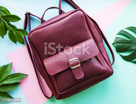 175597083 istock photo Burgundy leather backpack 1173072376