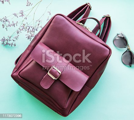 175597083 istock photo Burgundy leather backpack 1173072396